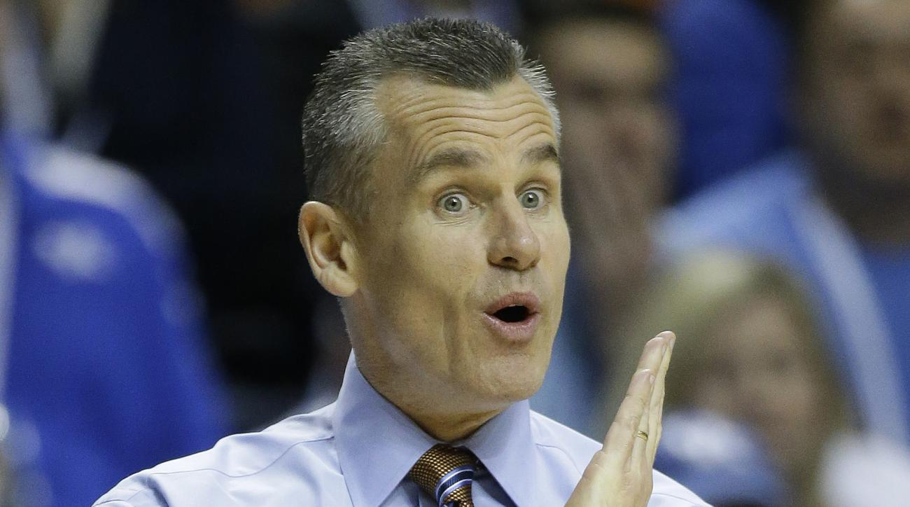 Florida head coach Billy Donovan speaks to players during the first half of an NCAA college basketball game in the quarter final round of the Southeastern Conference tournament between Kentucky and Florida, Friday, March 13, 2015, in Nashville, Tenn. (AP