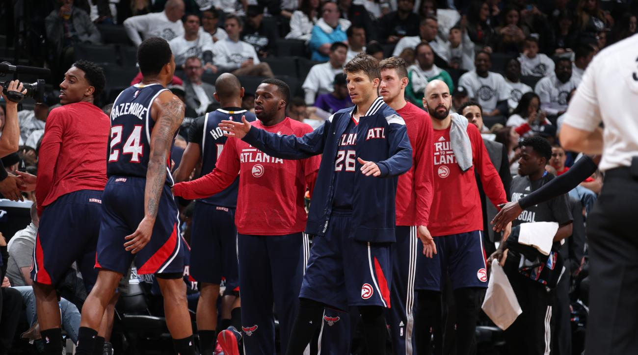 BROOKLYN, NY - MAY 1:  Kyle Korver #26 of the Atlanta Hawks celebrates with his teammates in Game Six of the Eastern Conference Quarterfinals against the Brooklyn Nets during the 2015 NBA Playoffs on May 1, 2015 at Barclays Center in Brooklyn, New York. (