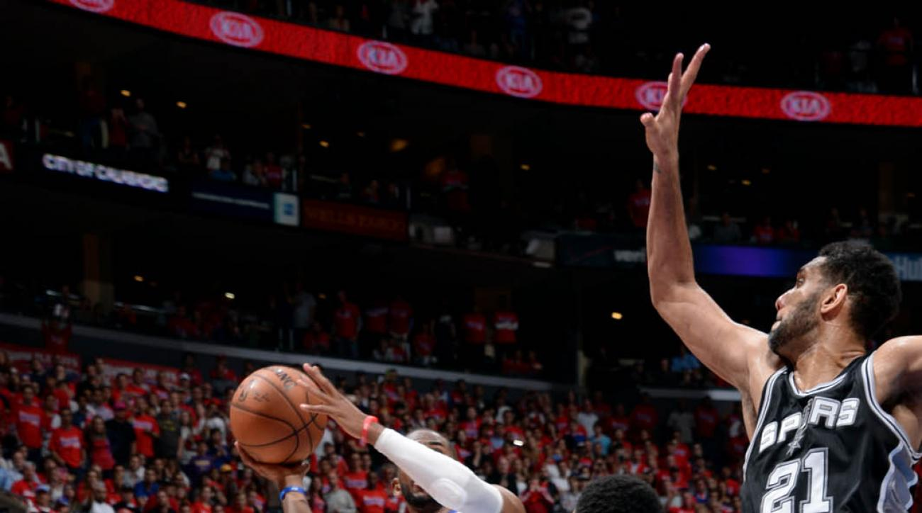 LOS ANGELES, CA - MAY 2: Chris Paul #3 of the Los Angeles Clippers shoots the game winning shot against the San Antonio Spurs in Game Seven of the Western Conference Quarterfinals during the 2015 NBA Playoffs on May  2, 2015 at STAPLES Center in Los Angel