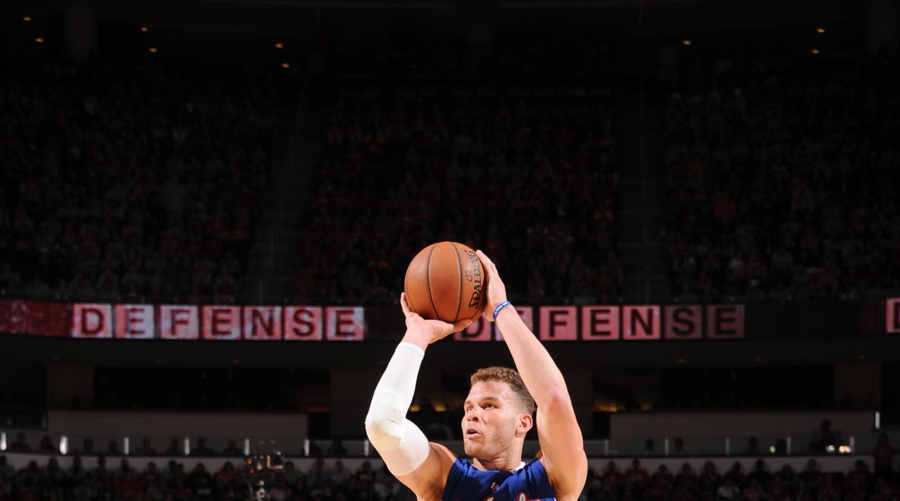 HOUSTON, TX - MAY 4:  Blake Griffin #32 of the Los Angeles Clippers shoots against the Houston Rockets in Game One of the Western Conference Semifinals during the 2015 NBA Playoffs on May 4, 2015 at the Toyota Center in Houston, Texas. (Photo by Bill Bapt
