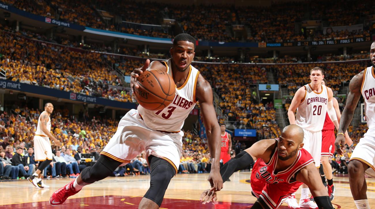 CLEVELAND, OH - MAY 4:  Tristan Thompson #13 of the Cleveland Cavaliers grabs the loose ball against Taj Gibson #22 of the Chicago Bulls in Game One of the Eastern Conference Semifinals during the 2015 NBA Playoffs on May 4, 2015 at Quicken Loans Arena in