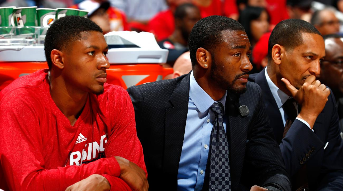 ATLANTA, GA - MAY 05:  John Wall #2 of the Washington Wizards sits on the bench with Bradley Beal #3 during Game Two of the Eastern Conference Semifinals of the 2015 NBA Playoffs against the Atlanta Hawks at Philips Arena on May 5, 2015 in Atlanta, Georgi