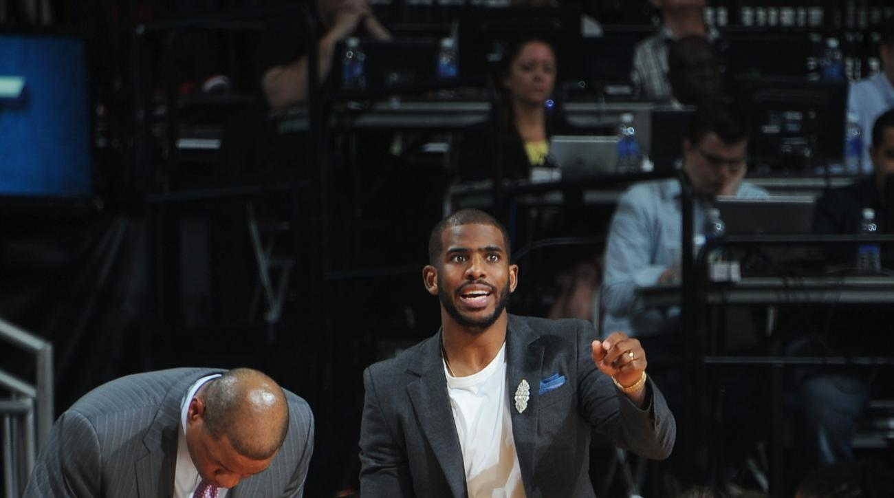 HOUSTON, TX - MAY 6:  Chris Paul #3 of the Los Angeles Clippers cheers on his team from the bench against the Houston Rockets in Game Two of the Western Conference Semifinals during the 2015 NBA Playoffs on May 6, 2015 at the Toyota Center in Houston, Tex