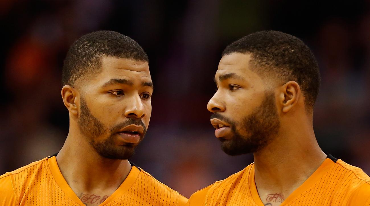 PHOENIX, AZ - NOVEMBER 07:  (L-R) Markieff Morris #11 and Marcus Morris #15 of the Phoenix Suns await a free throw shot during the second half of the NBA game against the Sacramento Kings at US Airways Center on November 7, 2014 in Phoenix, Arizona. The K