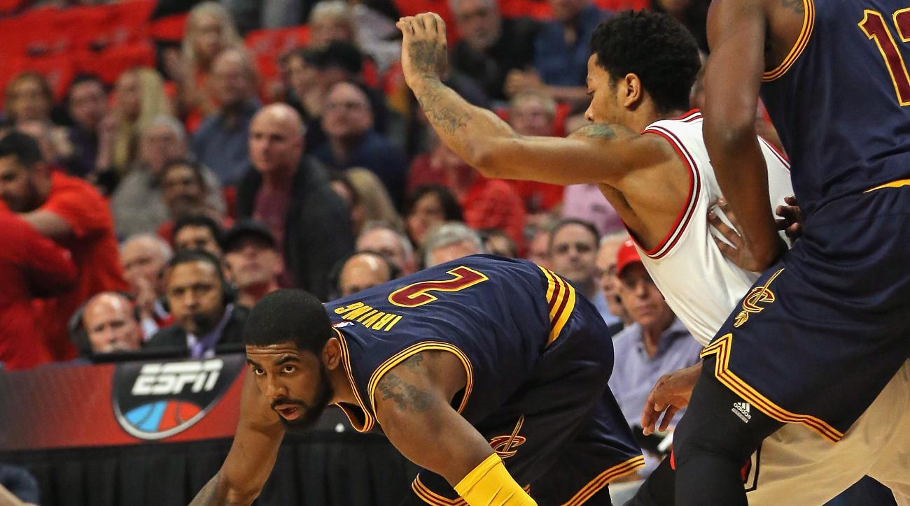 CHICAGO, IL - MAY 08: Kyrie Irving #2 of the Cleveland Cavaliers tries to keep his balance under pressure from Derrick Rose #1 of the Chicago Bulls in Game Three of the Eastern Conference Semifinals of the 2015 NBA Playoffs at the United Center on May 8,