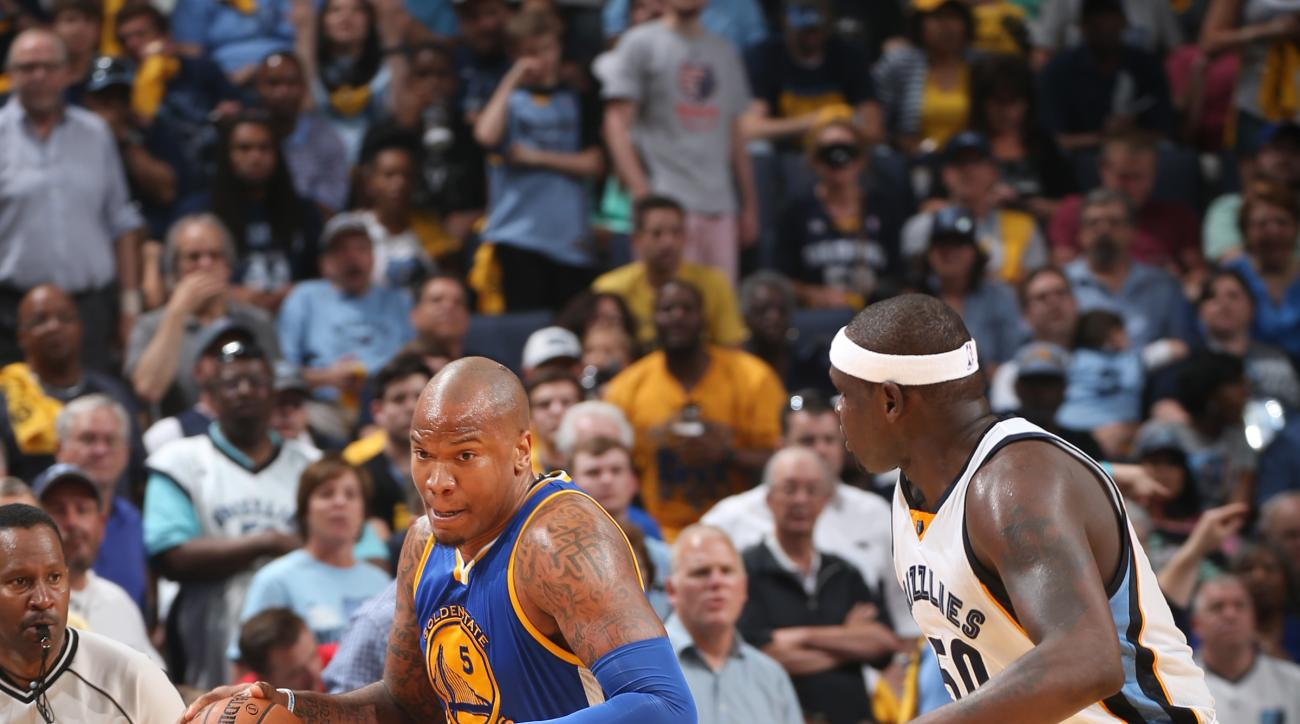 MEMPHIS, TN - MAY 9: Marreese Speights #5 of the Golden State Warriors drives to the basket against Zach Randolph #50 of the Memphis Grizzlies during Game Three of the Western Conference Semifinals of the NBA Playoffs on May 9, 2015 at FedExForum in Memph