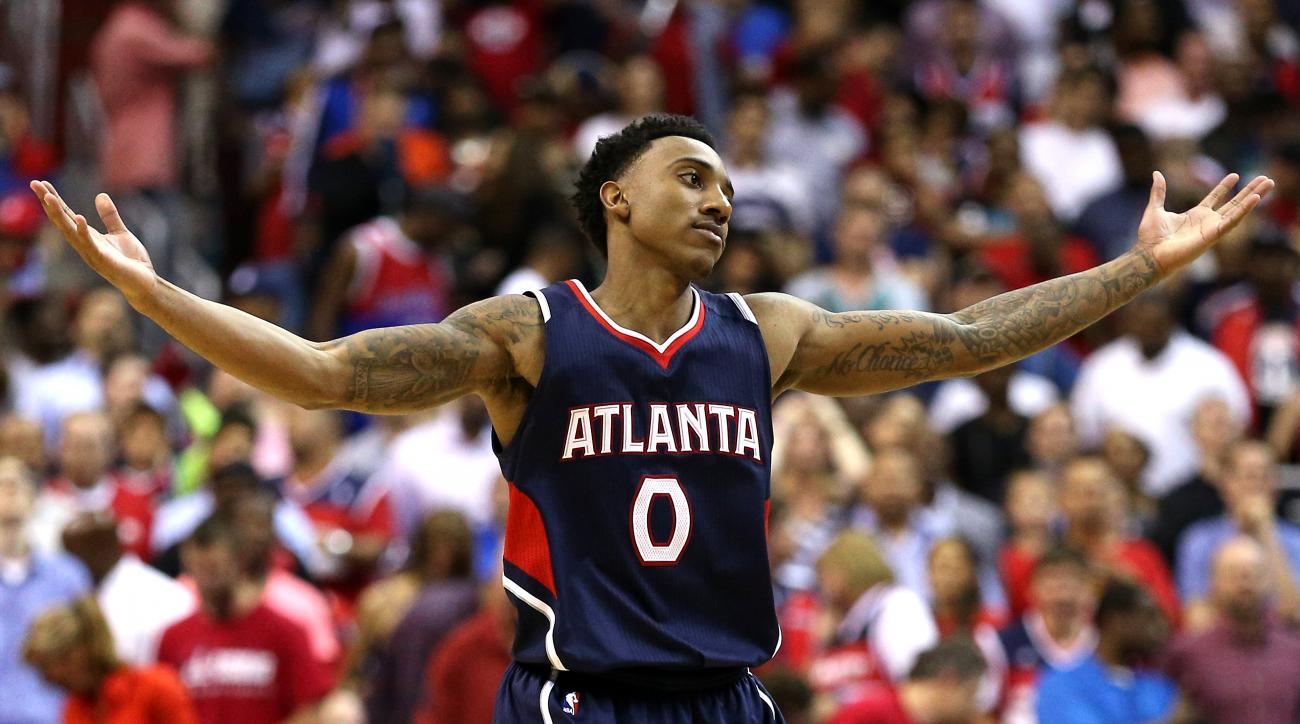 WASHINGTON, DC - MAY 11: Jeff Teague #0 of the Atlanta Hawks celebrates after hitting a shot against the Washington Wizards during the second half in Game Four of the Eastern Conference Semifinals of the 2015 NBA Playoffs at Verizon Center on May 11, 2015