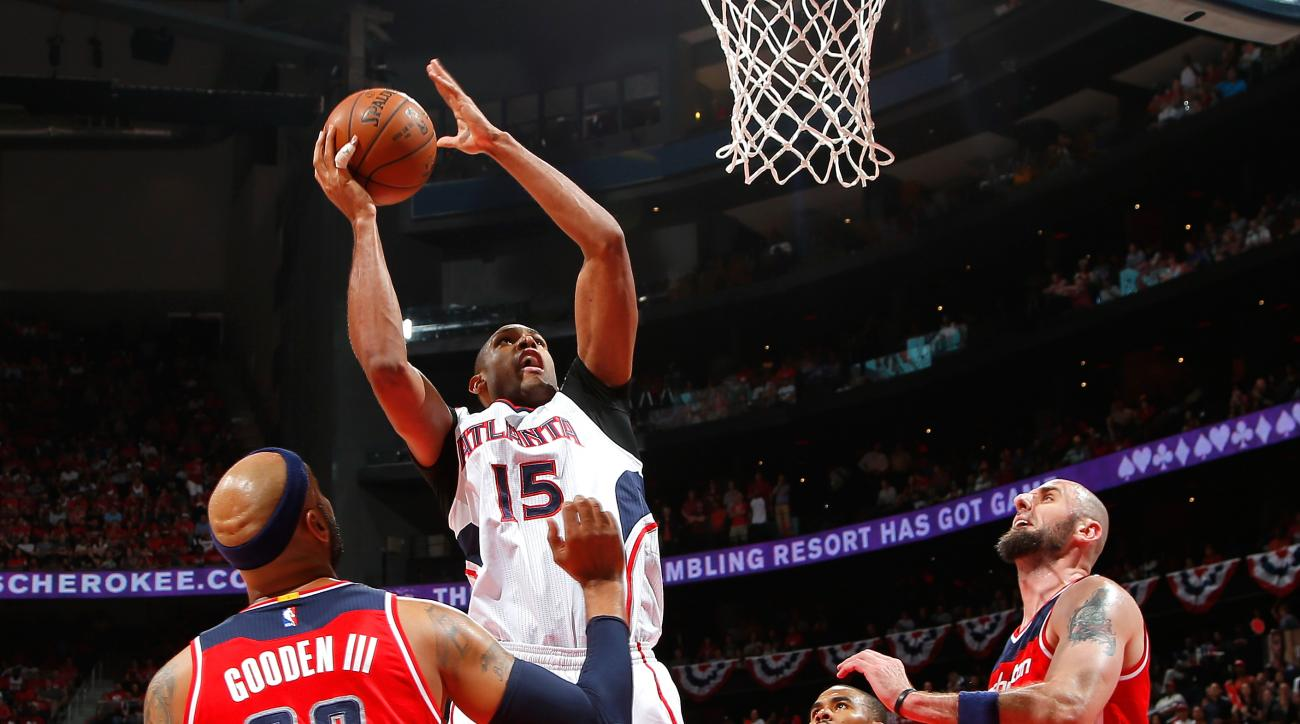 ATLANTA, GA - MAY 13:  Al Horford #15 of the Atlanta Hawks shoots over Drew Gooden #90, Ramon Sessions #7, and Marcin Gortat #4 of the Washington Wizards during Game Five of the Eastern Conference Semifinals of the 2015 NBA Playoffs at Philips Arena on Ma