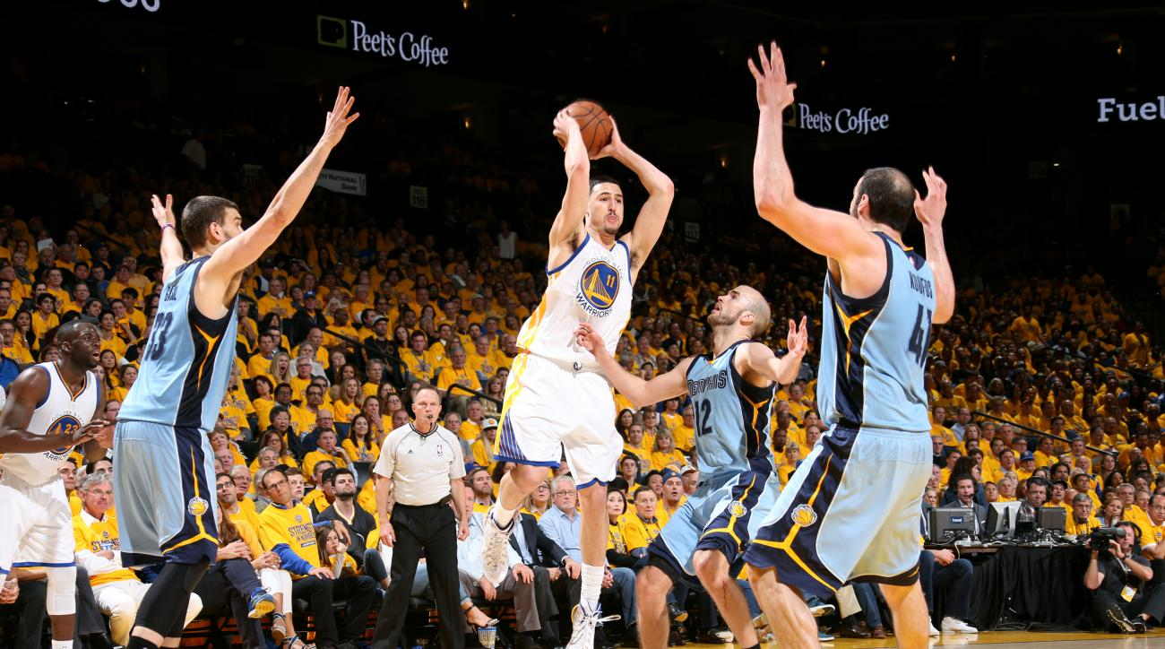 OAKLAND, CA - MAY 13: Klay Thompson #11 of the Golden State Warriors passes the ball against the Memphis Grizzlies in Game Five of the Western Conference Semifinals during the NBA Playoffs on May 13, 2015 at Oracle Arena in Oakland, California. (Photo by