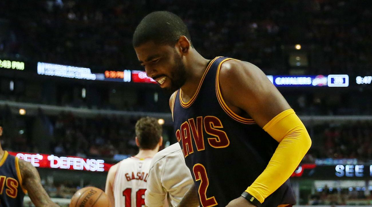 CHICAGO, IL - MAY 14:  Kyrie Irving #2 of the Cleveland Cavaliers reacts after being injured in the second quarter against the Chicago Bulls during Game Six of the Eastern Conference Semifinals of the 2015 NBA Playoffs at United Center on May 14, 2015 in