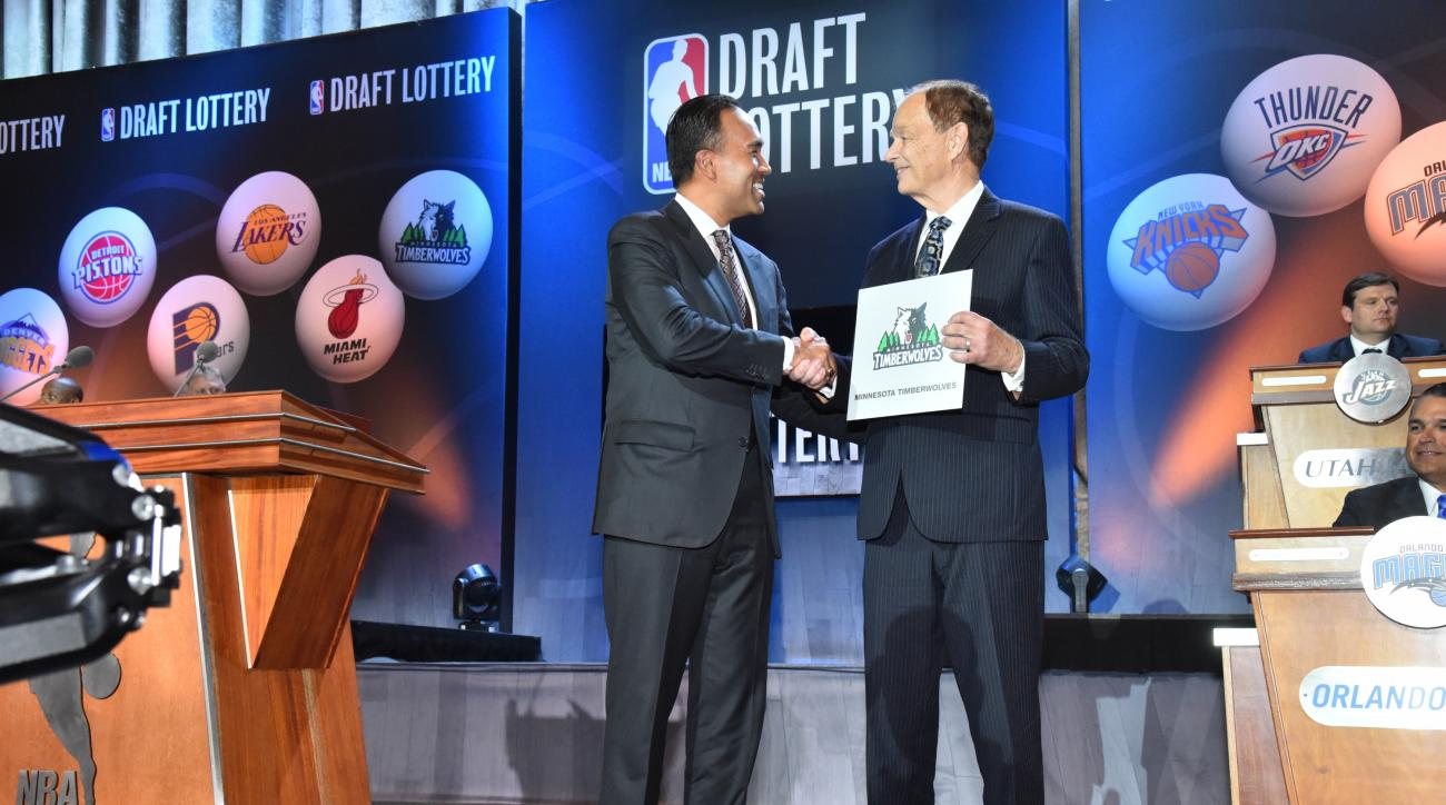 NEW YORK - MAY 19: NBA Deputy Commissioner Mark Tatum congrats Owner Glen Taylor of the Minnesota Timberwolves for winning the 2015 NBA Draft Lottery reception on May 19, 2015 at the New York Hilton Midtown in New York City.  (Photo by Jesse D. Garrabrant
