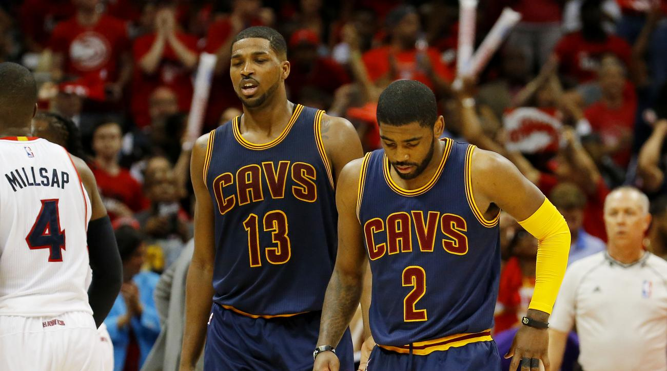 ATLANTA, GA - MAY 20:  Tristan Thompson #13 and Kyrie Irving #2 of the Cleveland Cavaliers react in the first half against the Atlanta Hawks during Game One of the Eastern Conference Finals of the 2015 NBA Playoffs at Philips Arena on May 20, 2015 in Atla