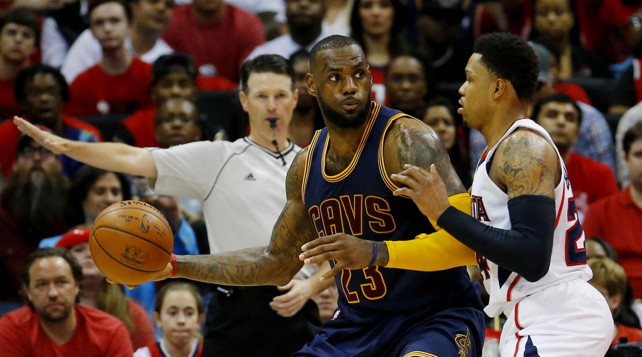 ATLANTA, GA - MAY 20:  LeBron James #23 of the Cleveland Cavaliers drives against Kent Bazemore #24 of the Atlanta Hawks in the second half during Game One of the Eastern Conference Finals of the 2015 NBA Playoffs at Philips Arena on May 20, 2015 in Atlan