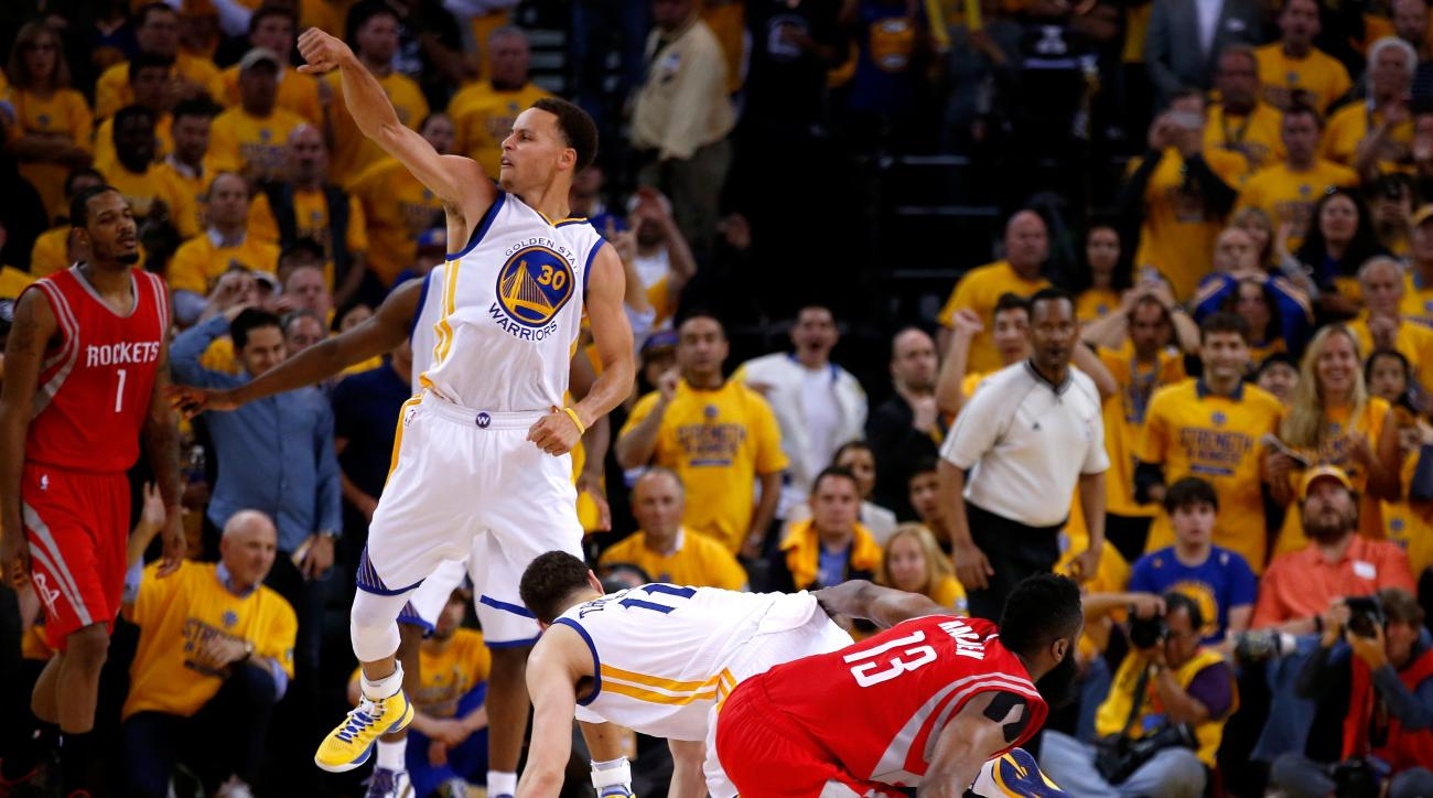 OAKLAND, CA - MAY 21:  Stephen Curry #30 of the Golden State Warriors reacts as James Harden #13 of the Houston Rockets fails to hold on to the ball as time expires during game two of the Western Conference Finals of the 2015 NBA PLayoffs at ORACLE Arena