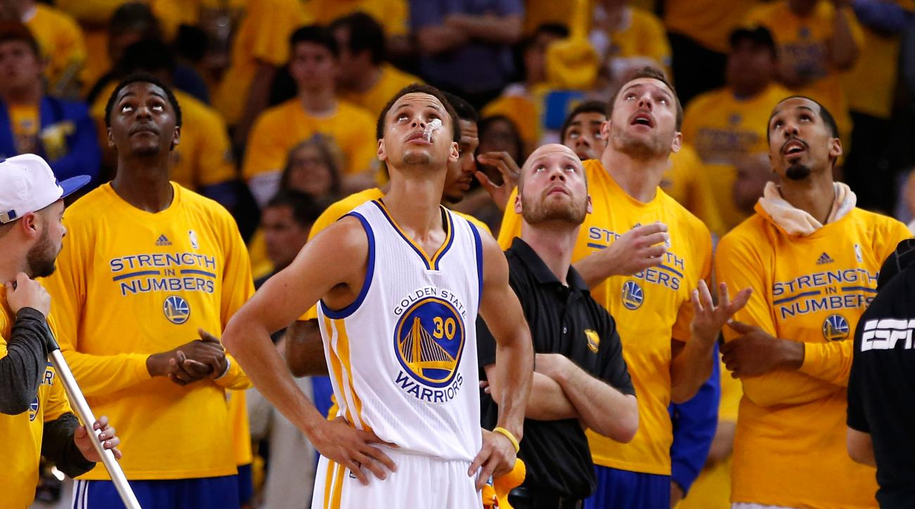 OAKLAND, CA - MAY 21: Stephen Curry #30 of the Golden State Warriors and teammates watch a replay in the second half against the Houston Rockets during game two of the Western Conference Finals of the 2015 NBA PLayoffs at ORACLE Arena on May 21, 2015 in O