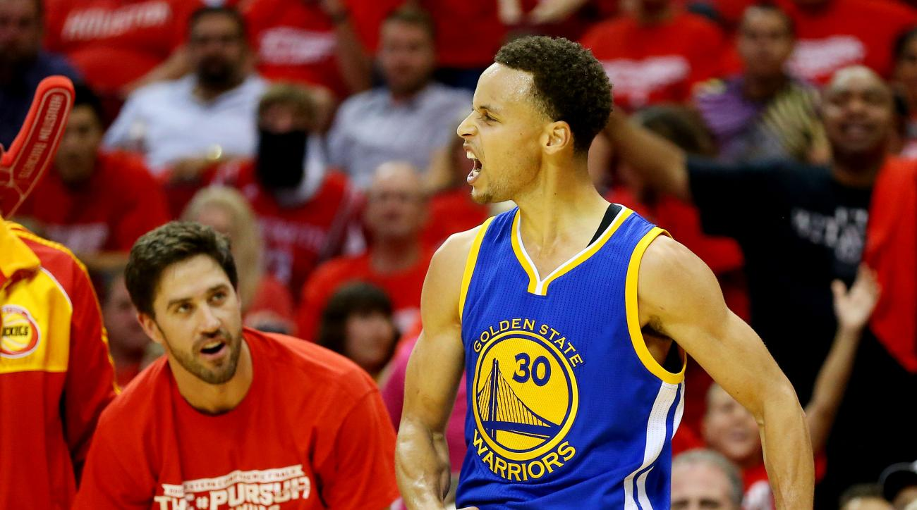 HOUSTON, TX - MAY 23:  Stephen Curry #30 of the Golden State Warriors reacts in the third quarter against the Houston Rockets during Game Three of the Western Conference Finals of the 2015 NBA PLayoffs at Toyota Center on May 23, 2015 in Houston, Texas. (