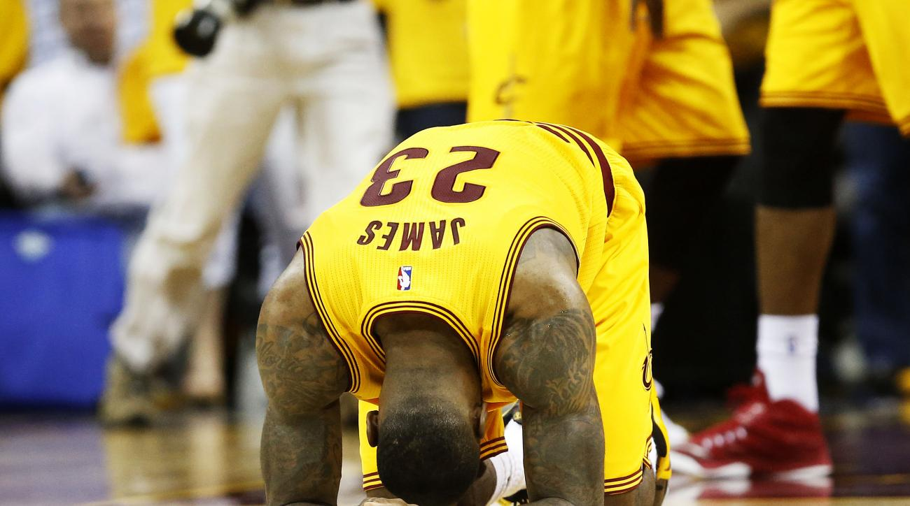 CLEVELAND, OH - MAY 24:  LeBron James #23 of the Cleveland Cavaliers react after their 114 to 111 win over the Atlanta Hawks in overtime during Game Three of the Eastern Conference Finals of the 2015 NBA Playoffs at Quicken Loans Arena on May 24, 2015 in