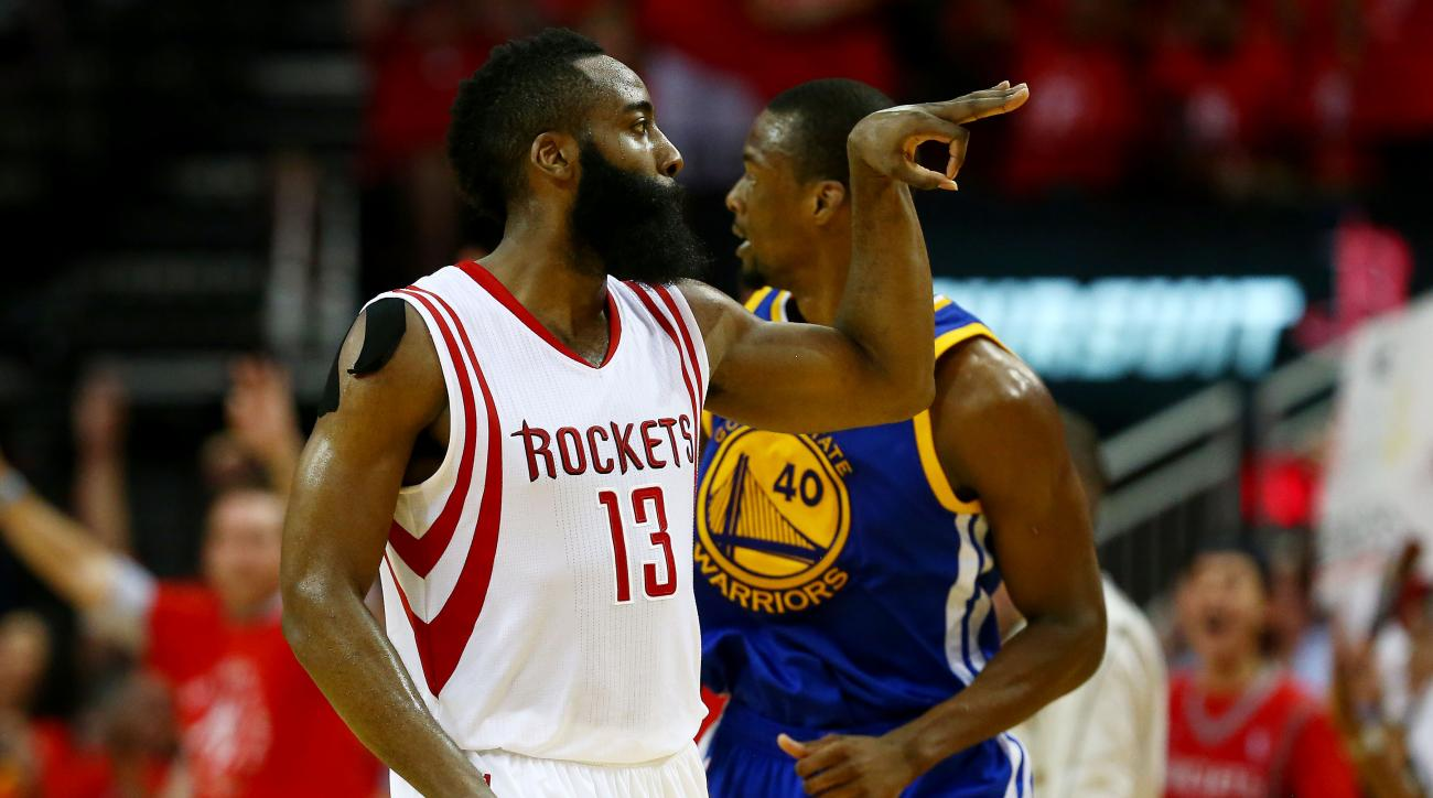 HOUSTON, TX - MAY 25:  James Harden #13 of the Houston Rockets celebrates in the fourth quarter as Harrison Barnes #40 of the Golden State Warriors looks on during Game Four of the Western Conference Finals of the 2015 NBA Playoffs at Toyota Center on May