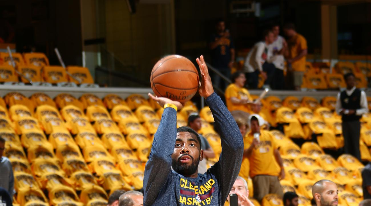CLEVELAND, OH - MAY 26: Kyrie Irving #2 of the Cleveland Cavaliers warms up before a game against the Atlanta Hawks in Game Four of the Eastern Conference Finals during the 2015 NBA Playoffs on May 26, 2015 at Quicken Loans Arena in Cleveland, Ohio.  (Pho