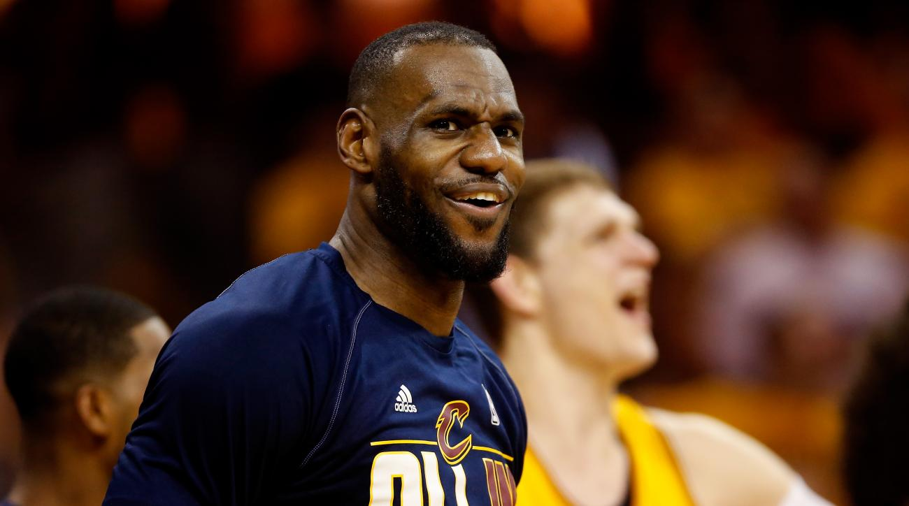 CLEVELAND, OH - MAY 26: LeBron James #23 of the Cleveland Cavaliers reacts on the bench in the fourth quarter against the Atlanta Hawks during Game Four of the Eastern Conference Finals of the 2015 NBA Playoffs at Quicken Loans Arena on May 26, 2015 in Cl