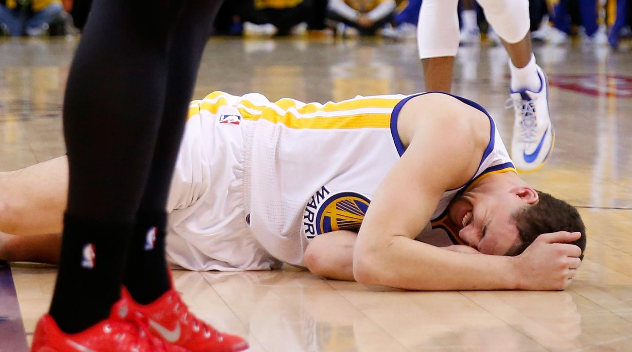 OAKLAND, CA - MAY 27:  Klay Thompson #11 of the Golden State Warriors is injured in the fourth quarter against the Houston Rockets during game five of the Western Conference Finals of the 2015 NBA Playoffs at ORACLE Arena on May 27, 2015 in Oakland, Calif