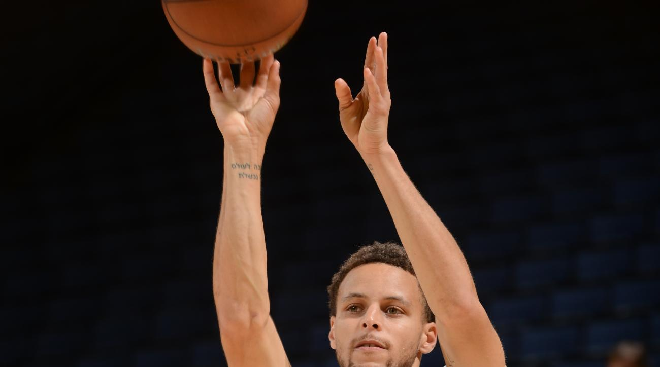OAKLAND, CA - JUNE 3: Stephen Curry of the Golden State Warriors shoots during practice and media availability as part of the 2015 NBA Finals on June 3 2015 at Oracle Arena in San Francisco , California. (Photo by Noah Graham/NBAE via Getty Images)
