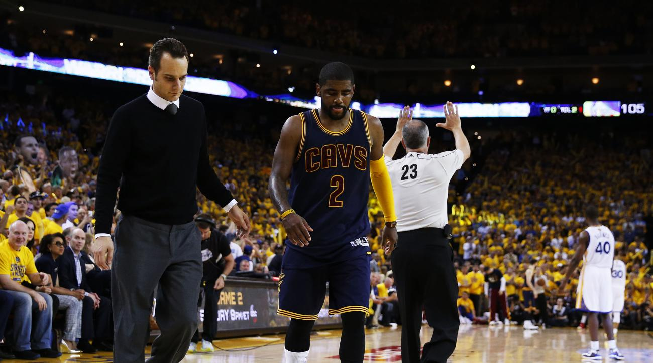 OAKLAND, CA - JUNE 04:  Kyrie Irving #2 of the Cleveland Cavaliers leaves the court injured in the second half against the Golden State Warriors during Game One of the 2015 NBA Finals at ORACLE Arena on June 4, 2015 in Oakland, California. (Photo by Ezra
