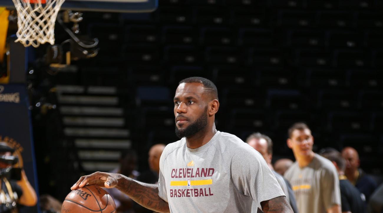 OAKLAND, CA - JUNE 6: LeBron James #23 of the Cleveland Cavaliers warms up during practice and media availability as part of the 2015 NBA Finals on June 6, 2015 at Oracle Arena in Oakland, California. (Photo by Nathaniel S. Butler/NBAE via Getty Images)