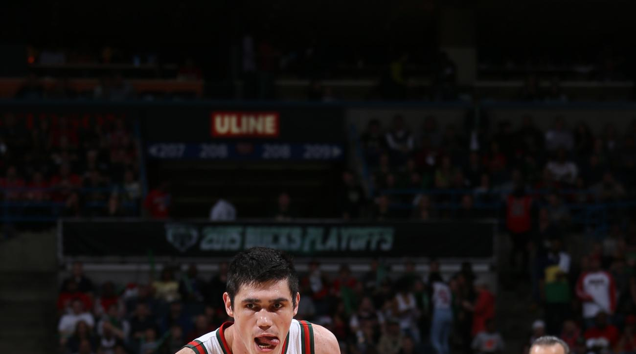 MILWAUKEE, WI - APRIL 23:  Ersan Ilyasova #7 of the Milwaukee Bucks brings the ball up court against the Chicago Bulls in Game Three of the Eastern Conference Quarterfinals during the 2015 NBA Playoffs on April 23, 2015 at the BMO Harris Bradley Center in