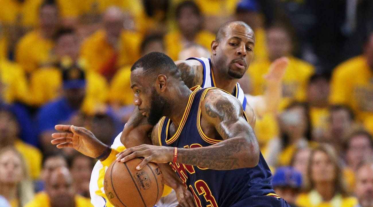 OAKLAND, CA - JUNE 14:  LeBron James #23 of the Cleveland Cavaliers drives against Andre Iguodala #9 of the Golden State Warriors in the first quarter during Game Five of the 2015 NBA Finals at ORACLE Arena on June 14, 2015 in Oakland, California. (Photo