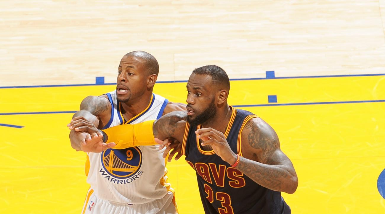 OAKLAND, CA - JUNE 14: Andre Iguodala #9 of the Golden State Warriors guards LeBron James of the Cleveland Cavaliers in Game Five of the 2015 NBA Finals on June 14, 2015 at Oracle Arena in Oakland, California. (Photo by Noah Graham/NBAE via Getty Images)