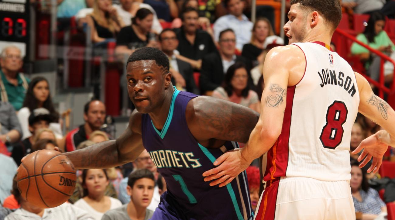 MIAMI, FL - APRIL 7:  Lance Stephenson #1 of the Charlotte Hornets drives to the basket against Tyler Johnson #8 of the Miami Heat on April 7, 2015 at American Airlines Arena in Miami, Florida.  (Photo by Issac Baldizon/NBAE via Getty Images)