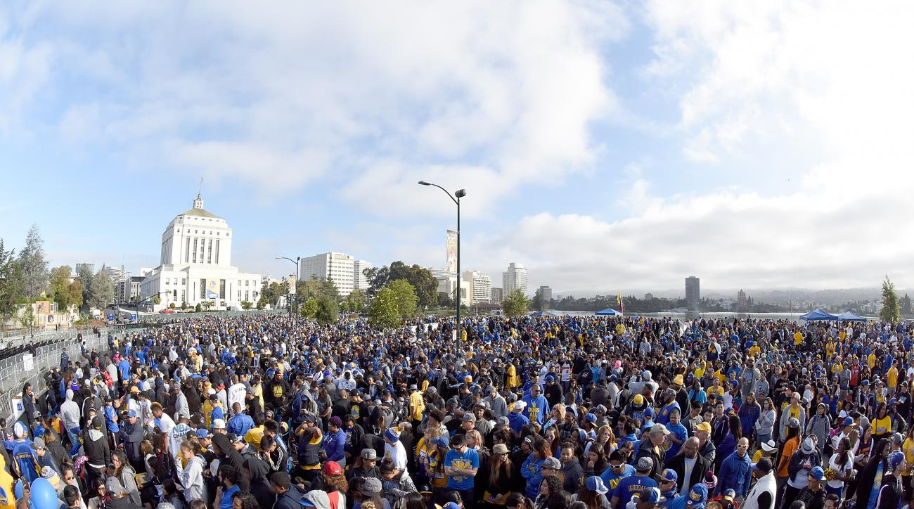 OAKLAND, CA - JUNE 19:  Fans gather together in front of the Henry J. Kaiser Convention Center and Alameda County Court House prior to the start of the Golden State Warriors Victory Parade and Rally on June 19, 2015 in Oakland, California.  (Photo by Thea