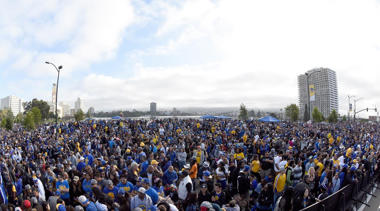 OAKLAND, CA - JUNE 19:  Fans gather together in front of the Henry J. Kaiser Convention Center prior to the start of the Golden State Warriors Victory Parade and Rally on June 19, 2015 in Oakland, California.  (Photo by Thearon W. Henderson/Getty Images)