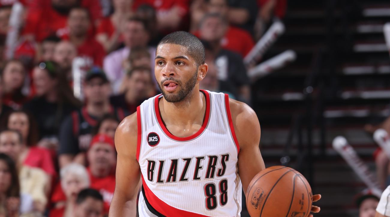 PORTLAND, OR - APRIL 27: Nicolas Batum #88 of the Portland Trail Blazers handles the ball against the Memphis Grizzlies in Game Four of the Western Conference Quarterfinals during the 2015 NBA Playoffs on April 27, 2015 at the Moda Center in Portland, Ore