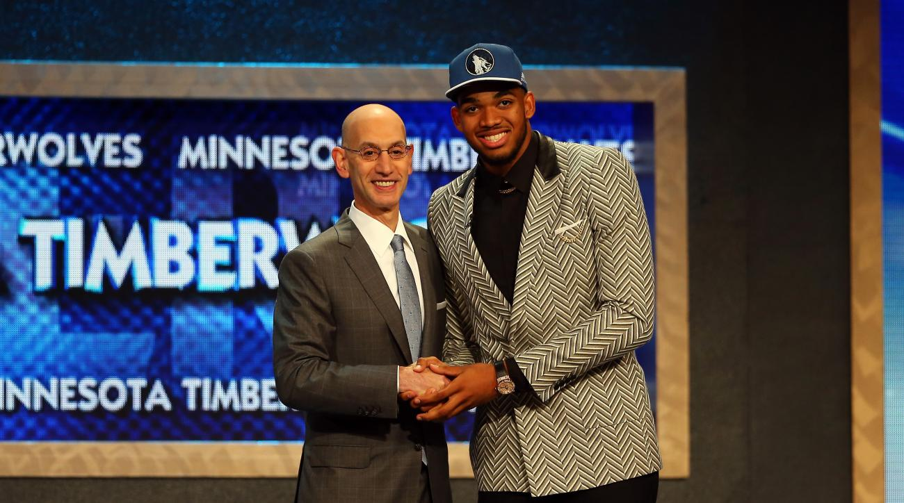 NEW YORK, NY - JUNE 25: Karl-Anthony Towns poses with Commissioner Adam Silver after being drafted first overall by the Minnesota Timberwolves in the First Round of the 2015 NBA Draft at the Barclays Center on June 25, 2015 in the Brooklyn borough of  New
