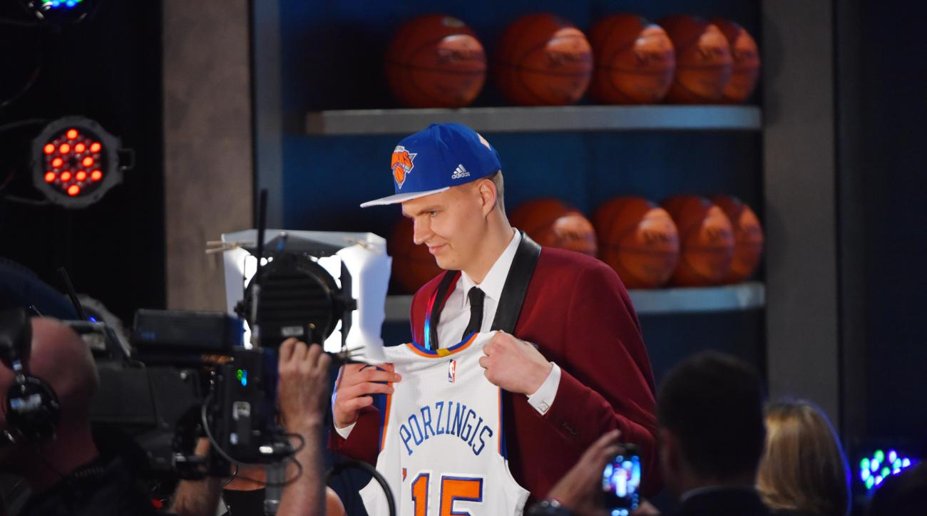 BROOKLYN, NY - JUNE 25:  Kristaps Porzingis the 4th pick overall in the 2015 NBA Draft by the New York Knicks during the 2015 NBA Draft at the Barclays Center on June 25, 2015 in the Brooklyn borough of New York City. (Photo by Jesse D. Garrabrant/NBAE vi
