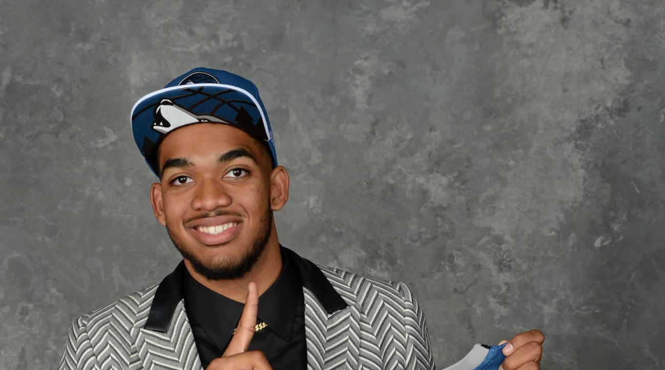 BROOKLYN, NY - JUNE 25:  Karl-Anthony Towns poses for a portrait after being drafted number one overall by the Minnesota Timberwolves during the 2015 NBA Draft at the Barclays Center on June 25, 2015 in the Brooklyn borough of New York City. (Photo by Jen