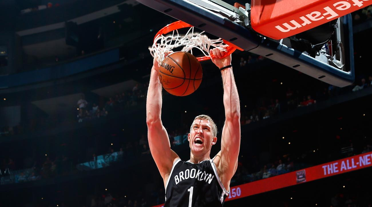 ATLANTA, GA - APRIL 22:  Mason Plumlee #1 of the Brooklyn Nets dunks against Jeff Teague #0 of the Atlanta Hawks during Game Two of the Eastern Conference Quarterfinals of the NBA Playoffs at Philips Arena on April 22, 2015 in Atlanta, Georgia.  (Photo by