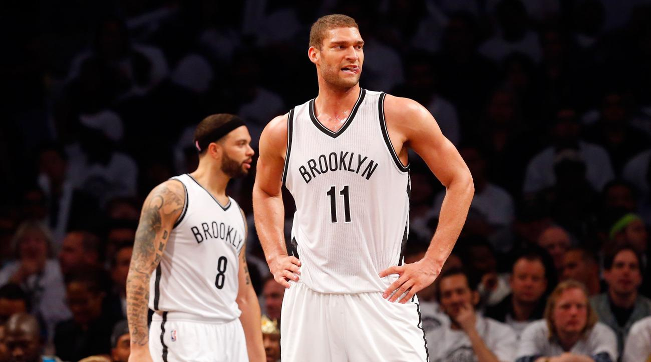 NEW YORK, NY - MAY 01:  Brook Lopez #11 and Deron Williams #8 of the Brooklyn Nets look on against the Atlanta Hawks during game six in the first round of the 2015 NBA Playoffs at Barclays Center on May 1, 2015 in the Brooklyn borough of New York City. (P