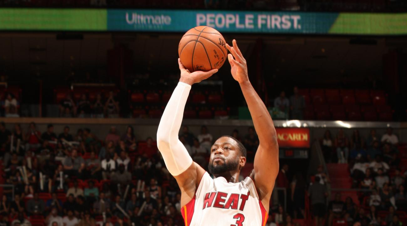 MIAMI, FL - APRIL 13:  Dwyane Wade #3 of the Miami Heat shoots against the Orlando Magic on April 13, 2015 at American Airlines Arena in Miami, Florida.  (Photo by Oscar Baldizon/NBAE via Getty Images)