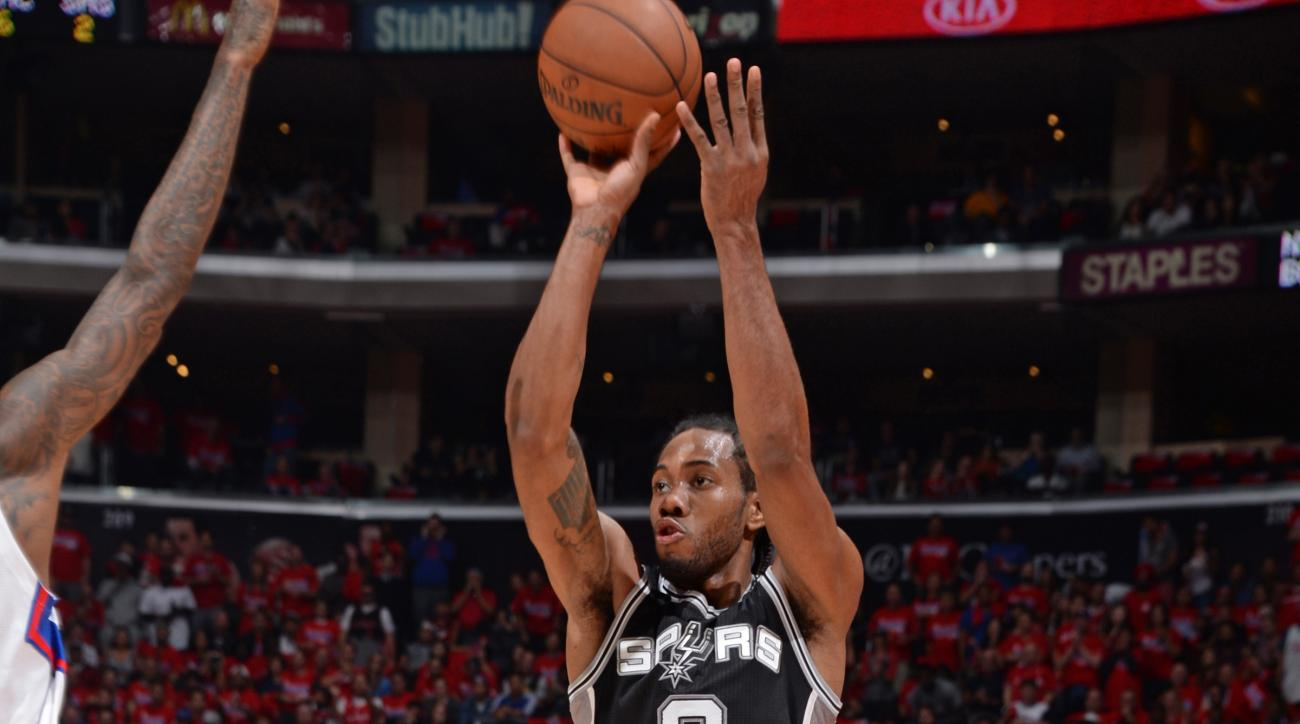LOS ANGELES, CA - MAY 2: Kawhi Leonard #2 of the San Antonio Spurs shoots against the Los Angeles Clippers in Game Seven of the Western Conference Quarterfinals during the 2015 NBA Playoffs on May  2, 2015 at STAPLES Center in Los Angeles, California. (Ph