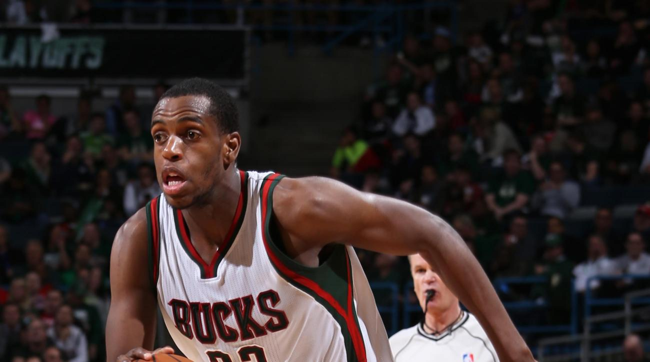 MILWAUKEE, WI - APRIL 30: Khris Middleton #22 of the Milwaukee Bucks handles the ball against the Chicago Bulls in Game Six of the Eastern Conference Quarterfinals of the 2015 NBA Playoffs on April 30, 2015 at BMO Harris Bradley Center in Milwaukee, Wisco