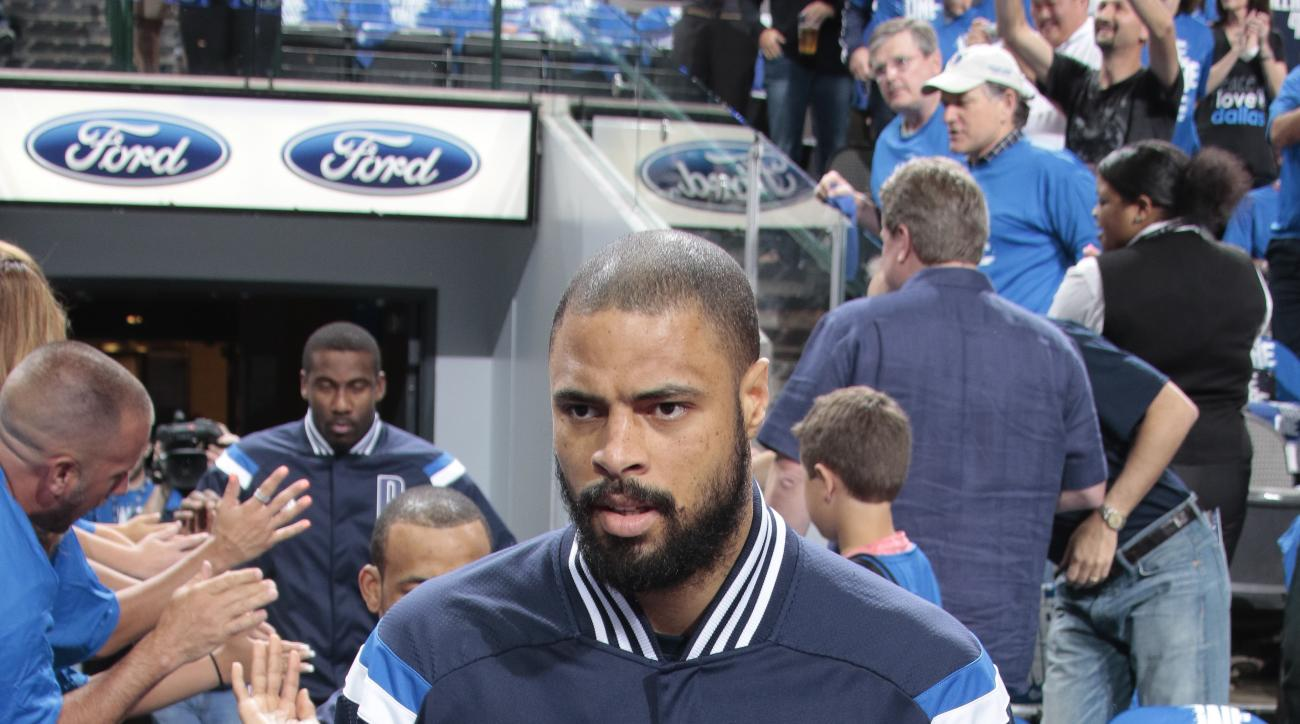 DALLAS, TX - APRIL 26: Tyson Chandler #6 of the Dallas Mavericks heads to the court before tip off against the Houston Rockets during Game Four of the Western Conference Quarterfinals of the 2015 NBA Playoffs on April 26, 2015 at the American Airlines Cen