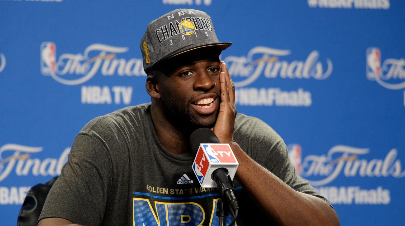 CLEVELAND, OH - JUNE 16:  Draymond Green #23 of the Golden State Warriors speaks to the media after they defeated the Cleveland Cavaliers in Game Six of the 2015 NBA Finals at Quicken Loans Arena on June 16, 2015 in Cleveland, Ohio. (Photo by Jason Miller