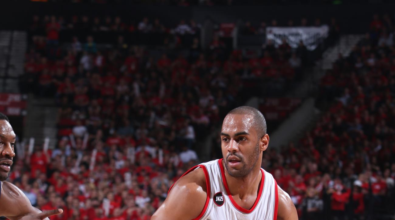 PORTLAND, OR - APRIL 27: Arron Afflalo #4 of the Portland Trail Blazers handles the ball against the Memphis Grizzlies in Game Four of the Western Conference Quarterfinals during the 2015 NBA Playoffs on April 27, 2015 at the Moda Center in Portland, Oreg