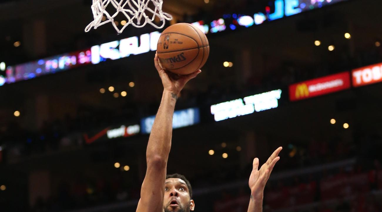 LOS ANGELES, CA - MAY 02:  Tim Duncan #21 of the San Antonio Spurs shoots over Chris Paul #3 and DeAndre Jordan #6 of the Los Angeles Clippers during Game Seven of the Western Conference quarterfinals of the 2015 NBA Playoffs at Staples Center on May 2, 2
