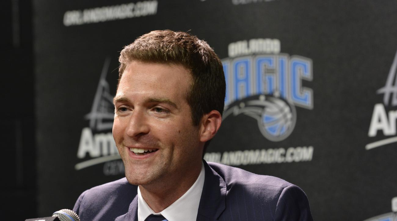 ORLANDO, FL - MAY 29:  Orlando Magic General Manager Rob Hennigan introduces new Magic head coach Scott Skiles during a press conference on May 29, 2015 at Amway Center in Orlando, Florida. (Photo by Fernando Medina/NBAE via Getty Images)