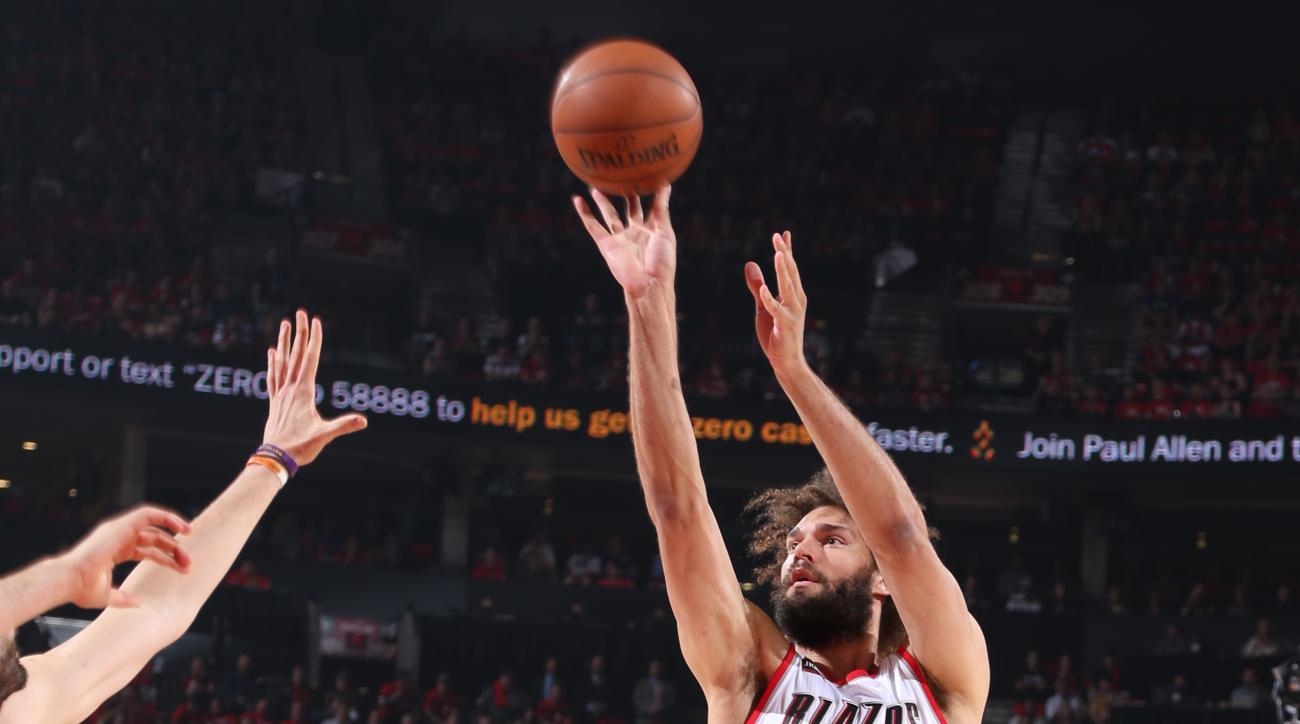 PORTLAND, OR - APRIL 27: Robin Lopez #42 of the Portland Trail Blazers takes a shot against the Memphis Grizzlies in Game Four of the Western Conference Quarterfinals during the 2015 NBA Playoffs on April 27, 2015 at the Moda Center in Portland, Oregon. (