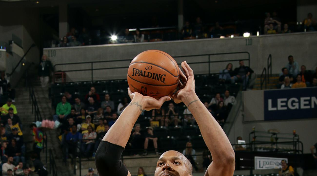 INDIANAPOLIS - APRIL 5: David West #21 of the Indiana Pacers attempts a free throw against the Miami Heat at Bankers Life Fieldhouse on April 5, 2015 in Indianapolis, Indiana.  (Photo by Ron Hoskins/NBAE via Getty Images)